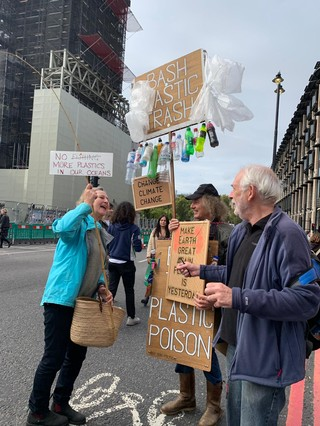 XR protestors in London with signs
