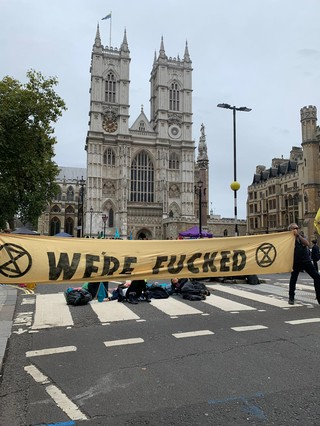 XR protest 'We're Fucked' banner in London