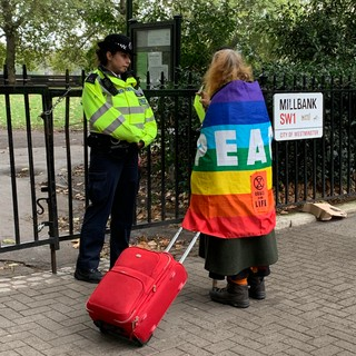 XR protestor with police officer in London