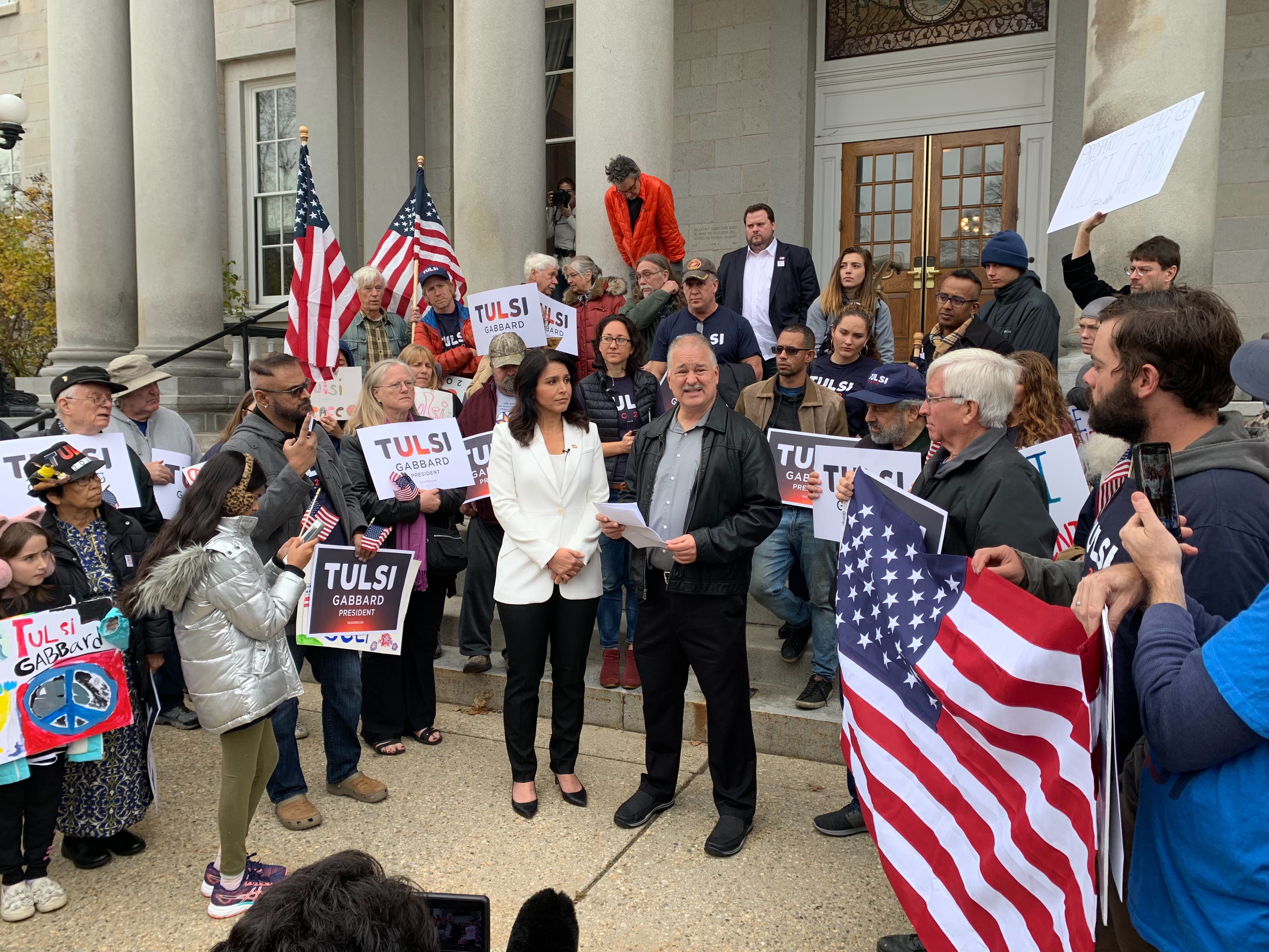 Gabbard and 9/11 survivor Tim Frolich address supporters at the New Hampshire statehouse.