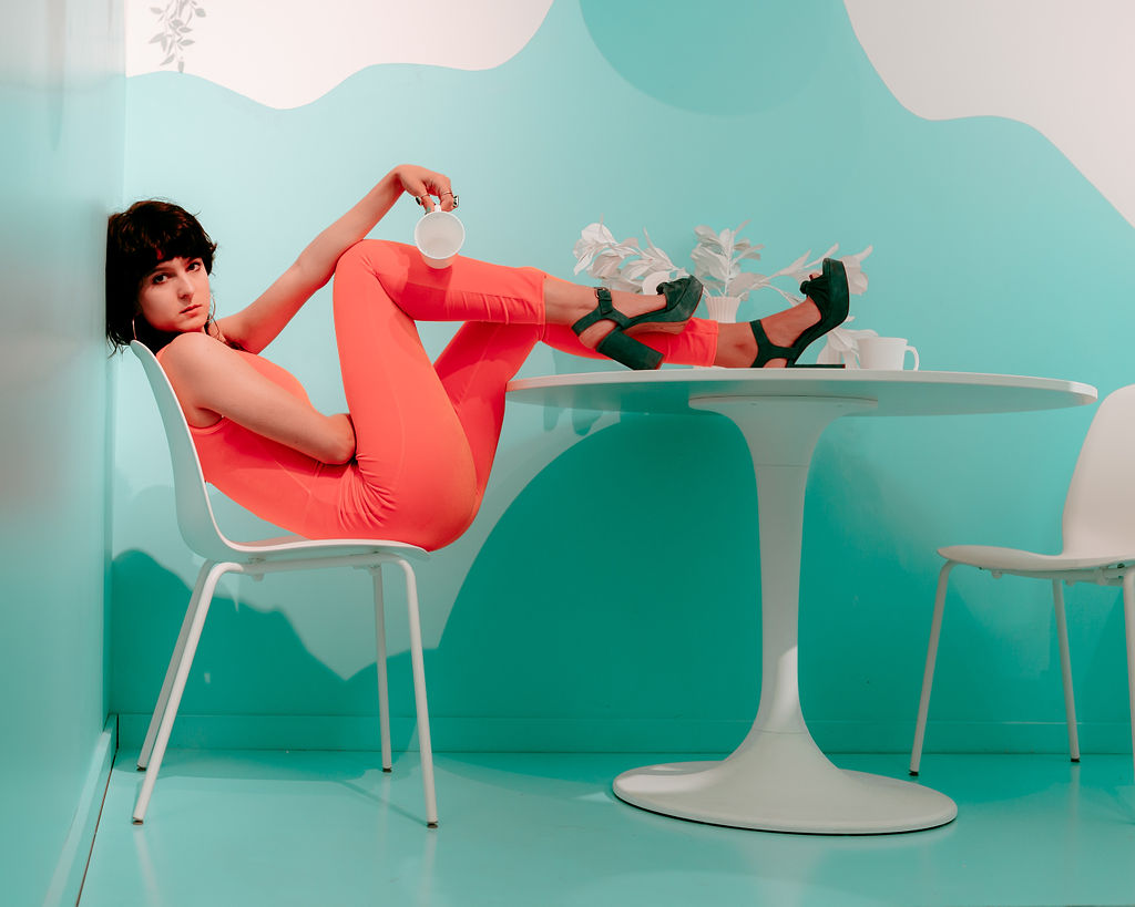 Isa Mazzei poses at a table