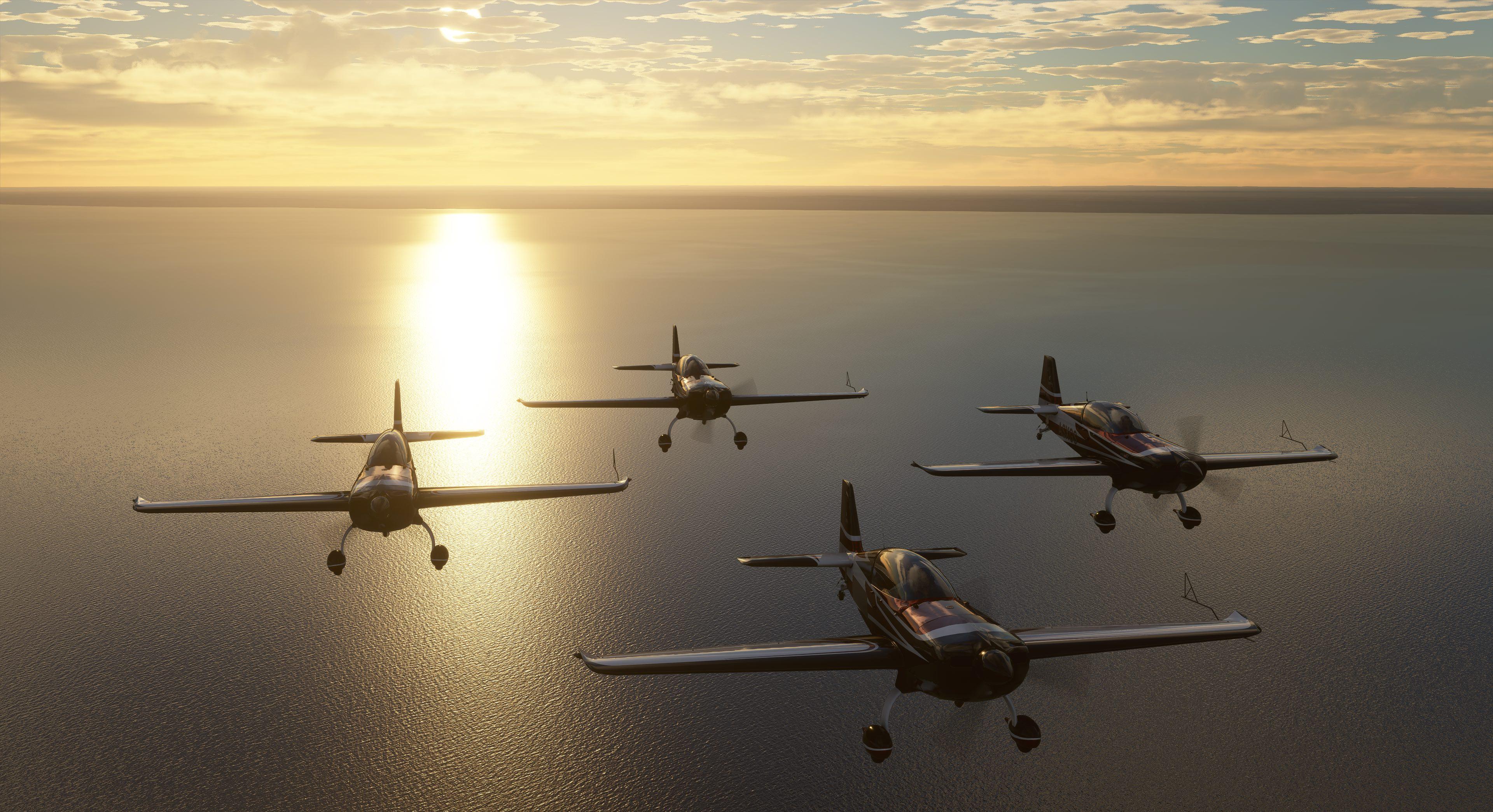 Pemandangan matahari terbenam di belakang empat pesawat dalam game Flight Simulator 2020