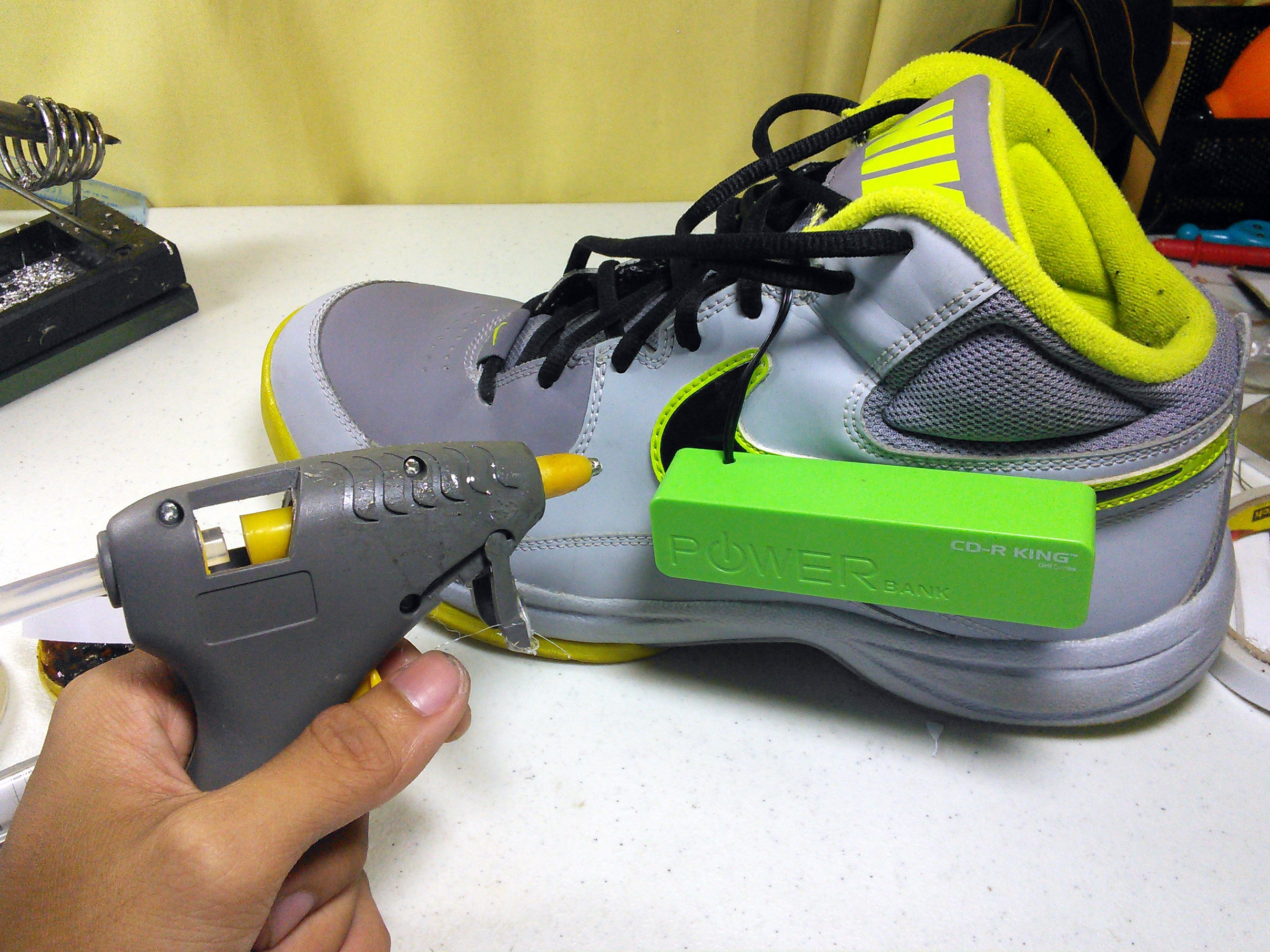 A powerbank is soldered to the side of the shoe