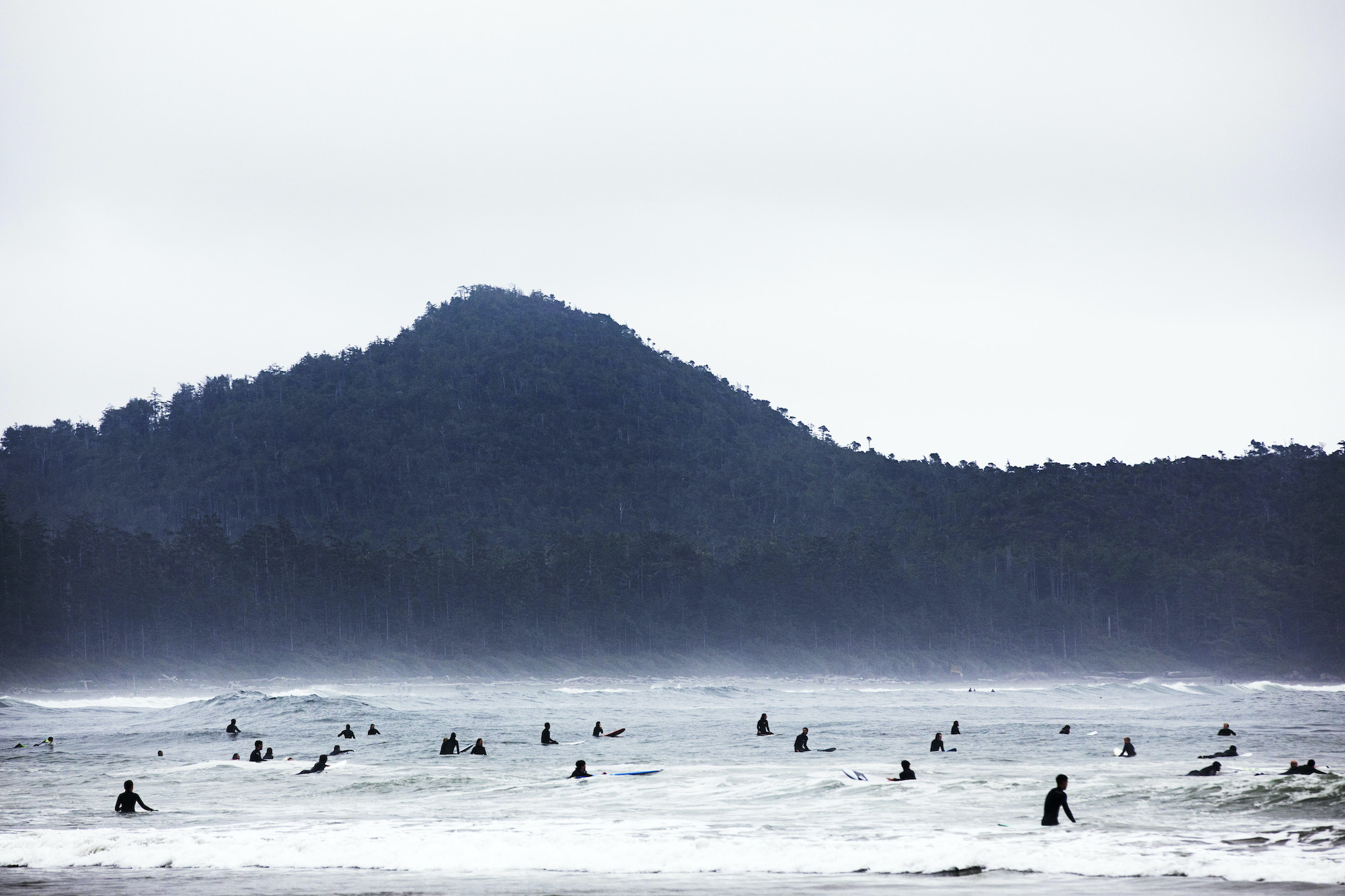 Visitors flock to Chesterman Beach in Tofino to surf