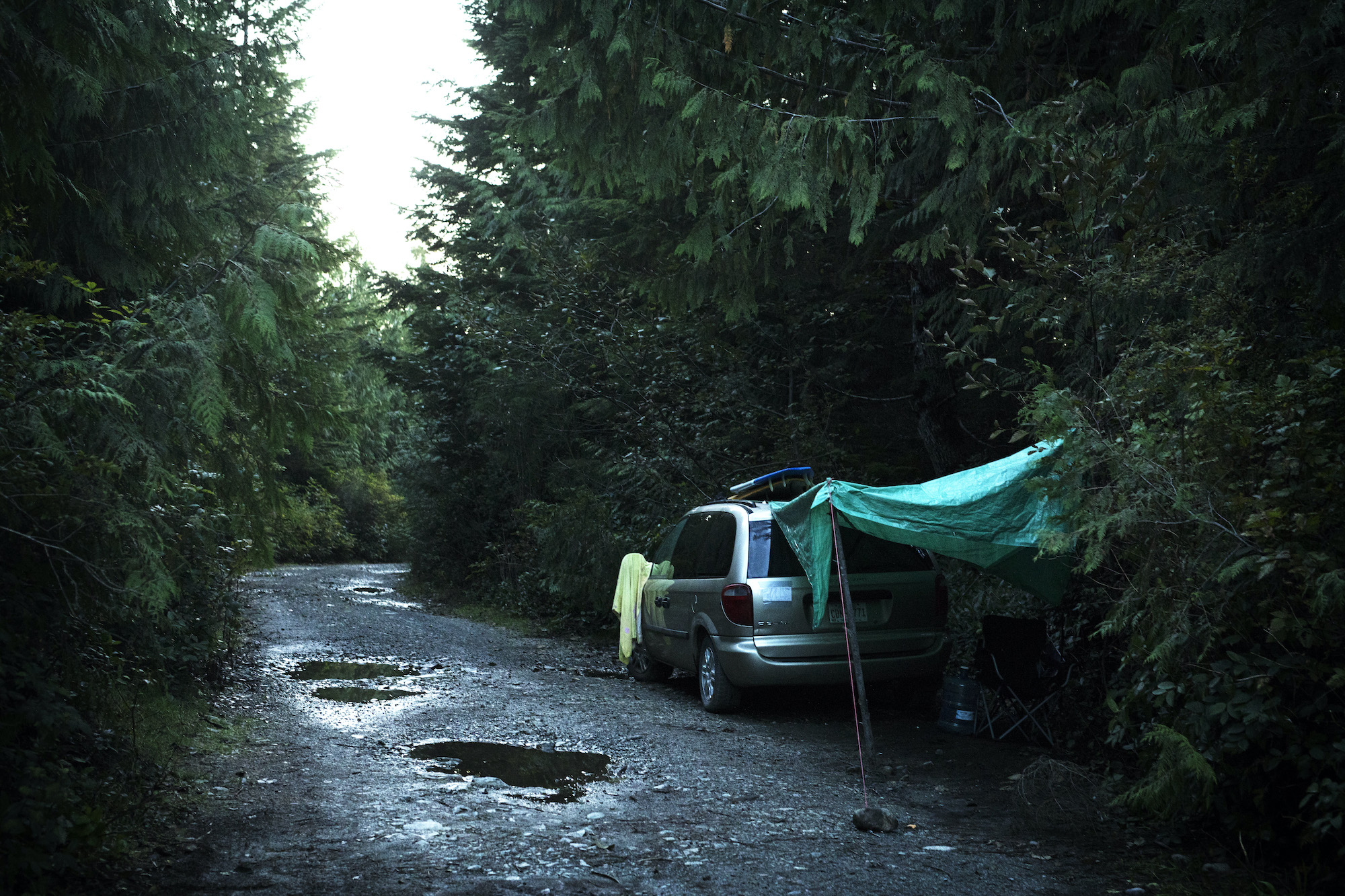 A van is stationed down one of the logging roads leading into Tofino