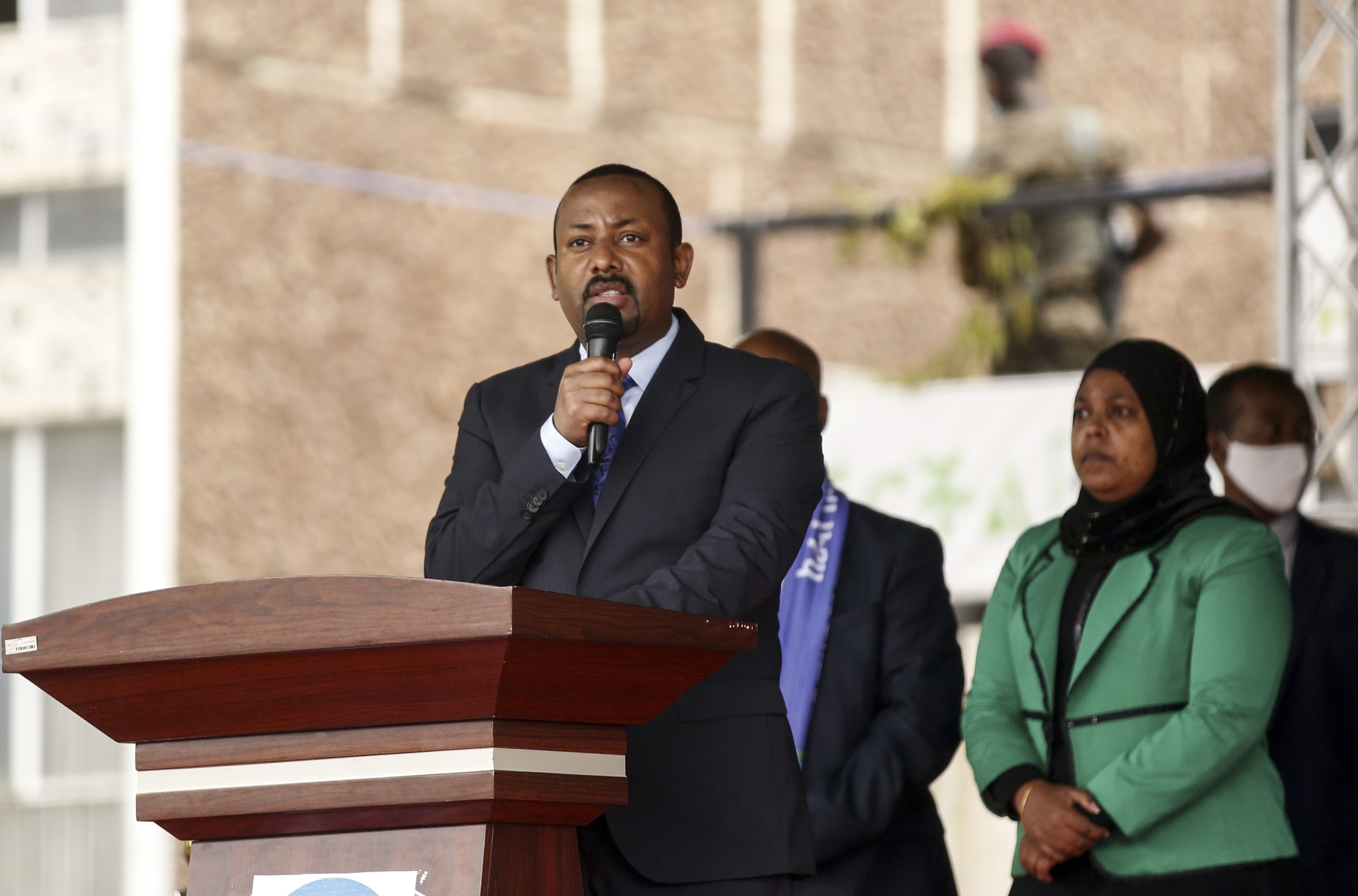 Prime Minister Abiy Ahmed addresses a crowd from a podium.