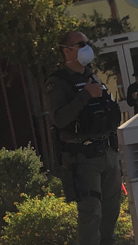 An armed police officers stands outside a polling site. Image courtesy of Arizona Native Votes