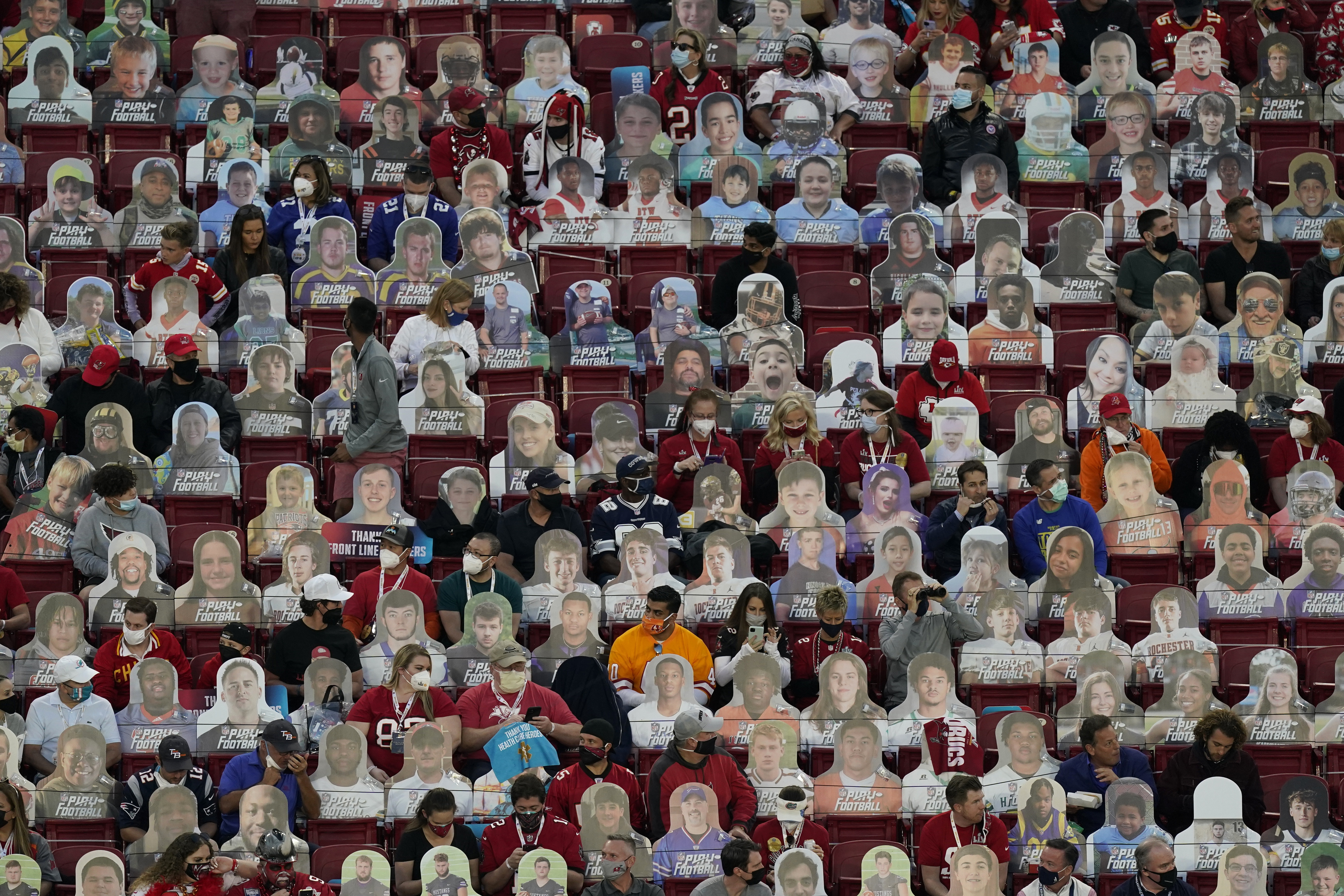 Fans sit among cardboard cutouts before the NFL Super Bowl 55 football game between the Kansas City Chiefs and Tampa Bay Buccaneers, Sunday, Feb. 7, 2021, in Tampa, Fla.