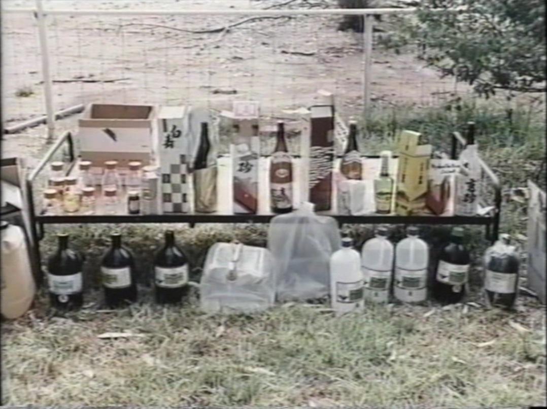 Barang bukti berupa botol sake dan wadah zat kimia kosong