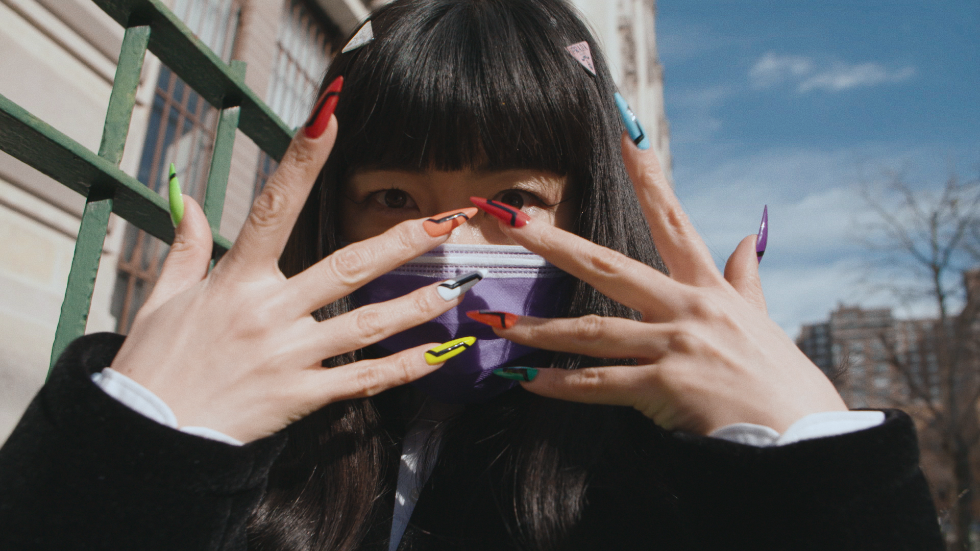 still from i-D short film glam squad. image of Mei and her nails.