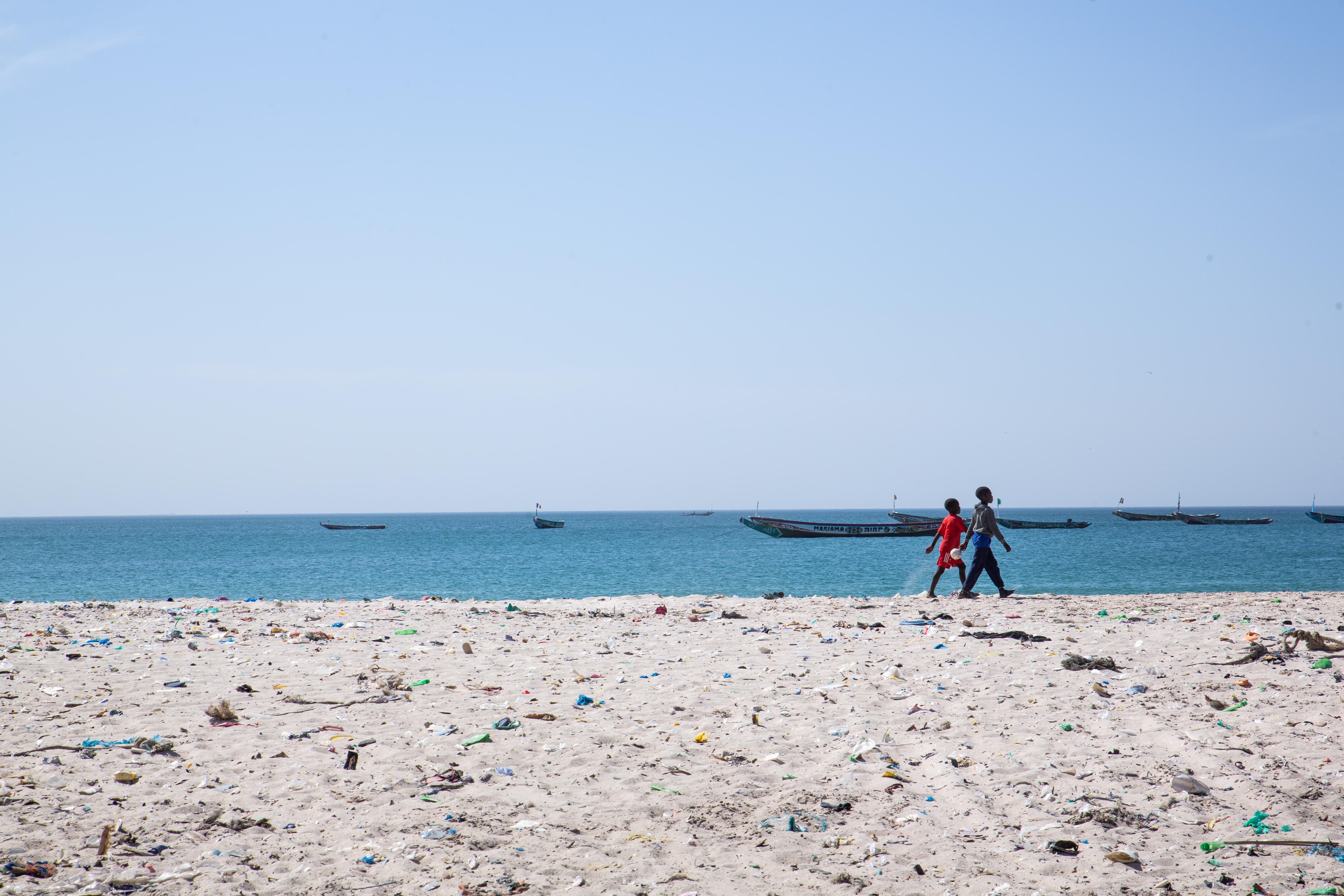 Children walk along Bargny's coast.