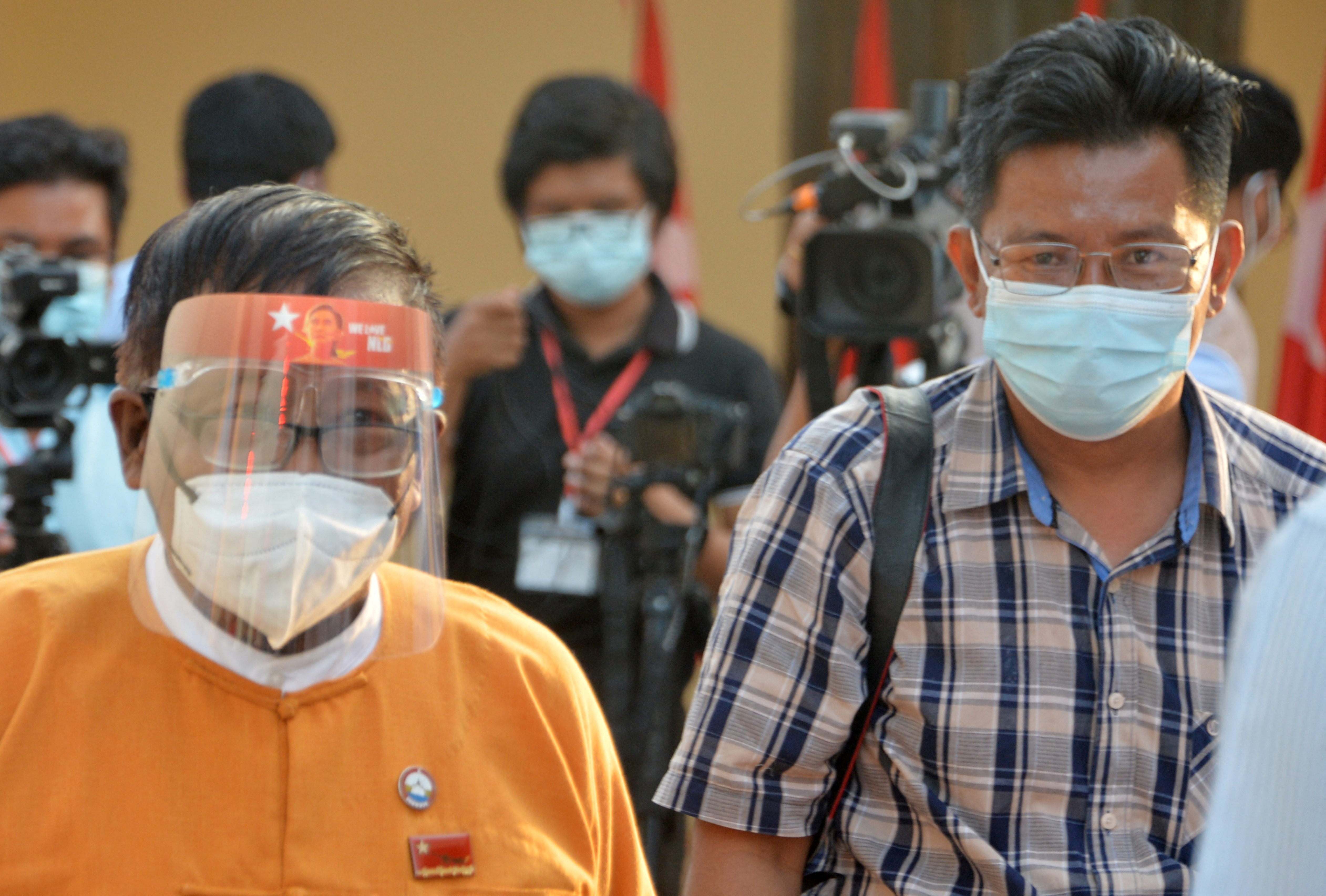 BBC Burmese journalist Aung Thura (right) leaves after a press briefing in Naypyidaw. PHOTO: AFP