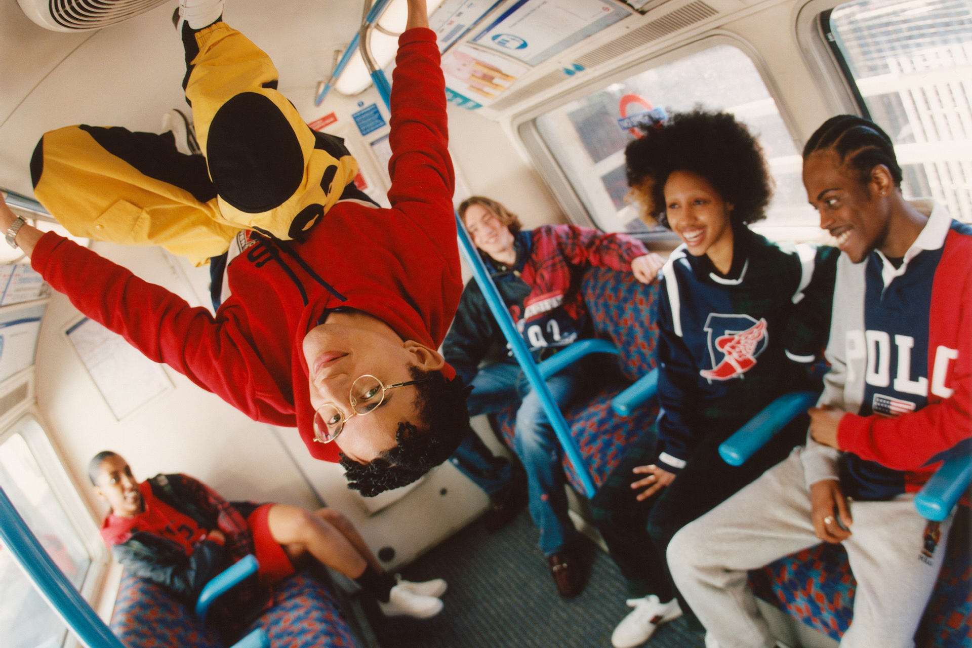 Image of a group of young models sat in a London underground carriage, wearing bright, Browns-exclusive Polo Ralph Lauren garments