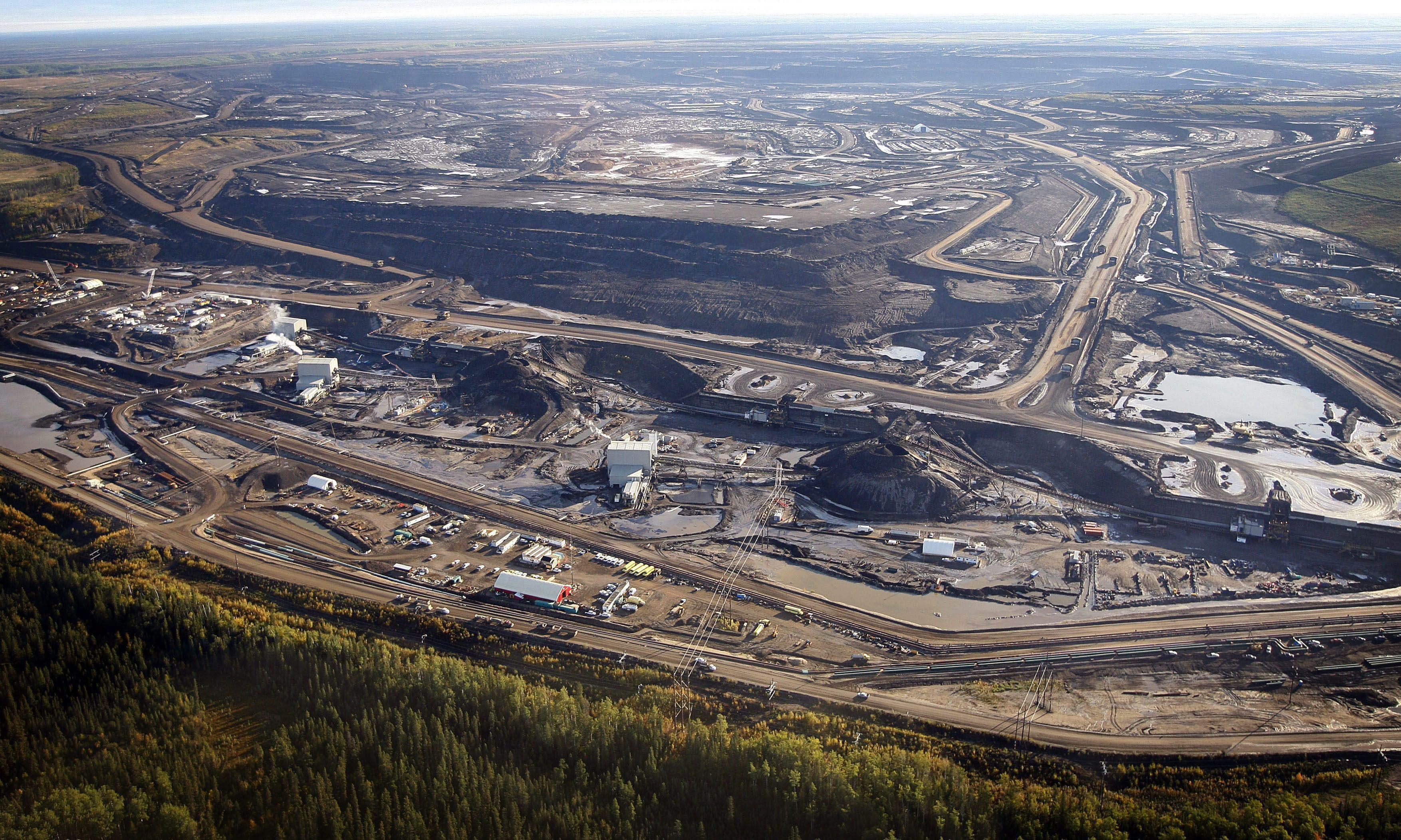 Good money comes at a cost to the land.  A tar sands mine facility near Fort McMurray, Alberta.