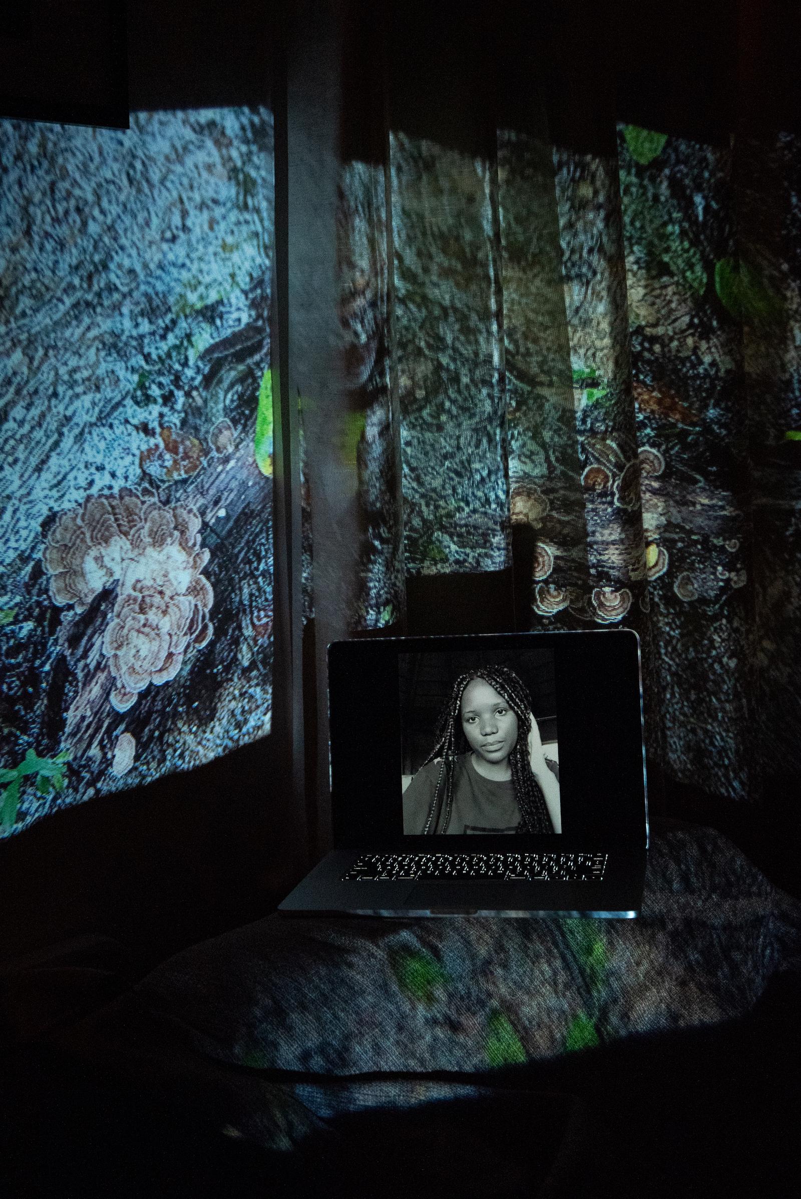 Veronica Mulenga, Youth Climate Save Zambia Organizer. Projected Image: En en el Arroyo, Lacandon Jungle, Mexico, December 2020.