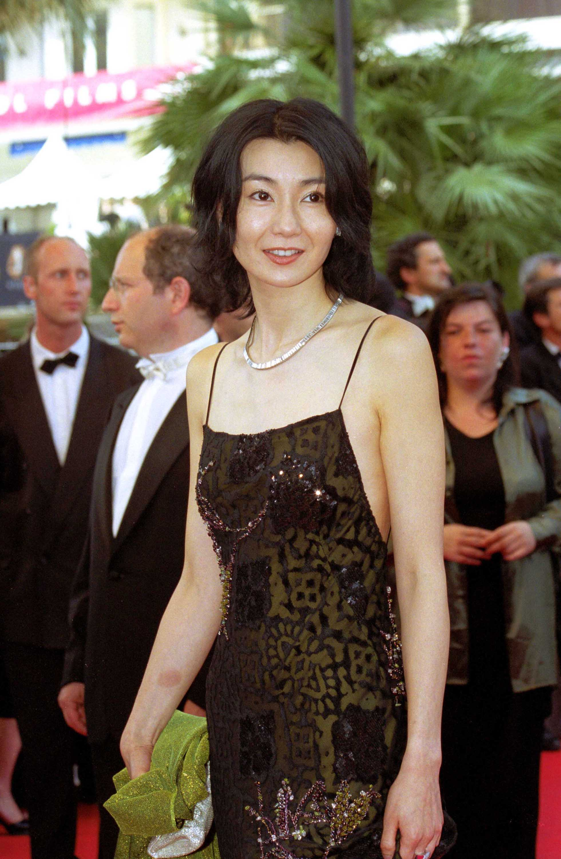 maggie cheung smiling on the red carpet at cannes film festival
