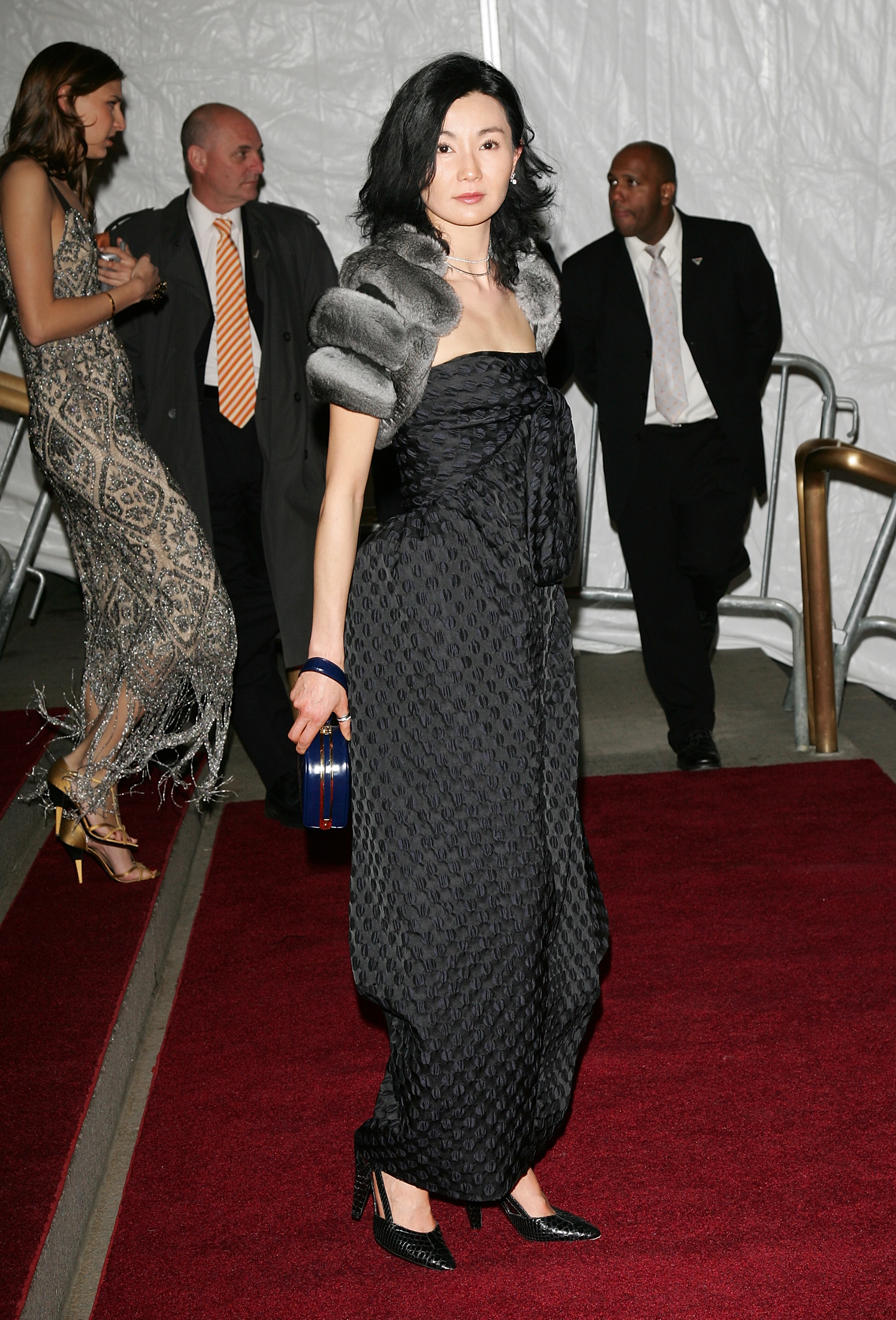 maggie cheung poses on the red carpet at the met gala