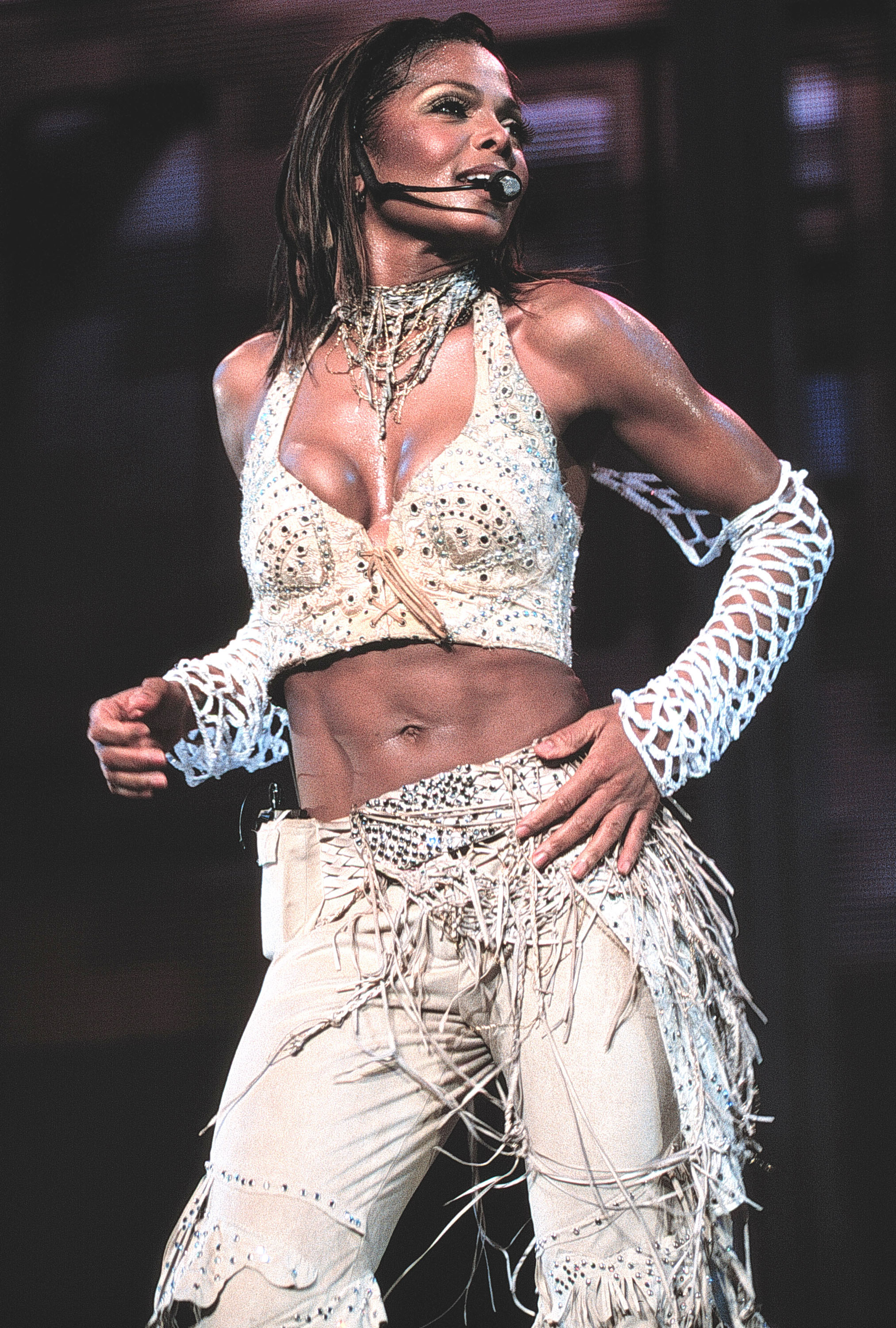 janet jackson singing onstage at madison square garden in a fringed two piece