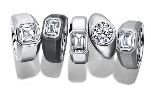 five silver tiffany & co diamond rings in a line