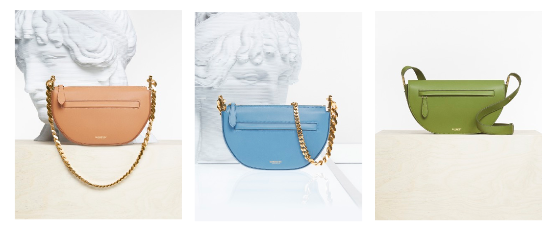 three burberry handbags with gold chains