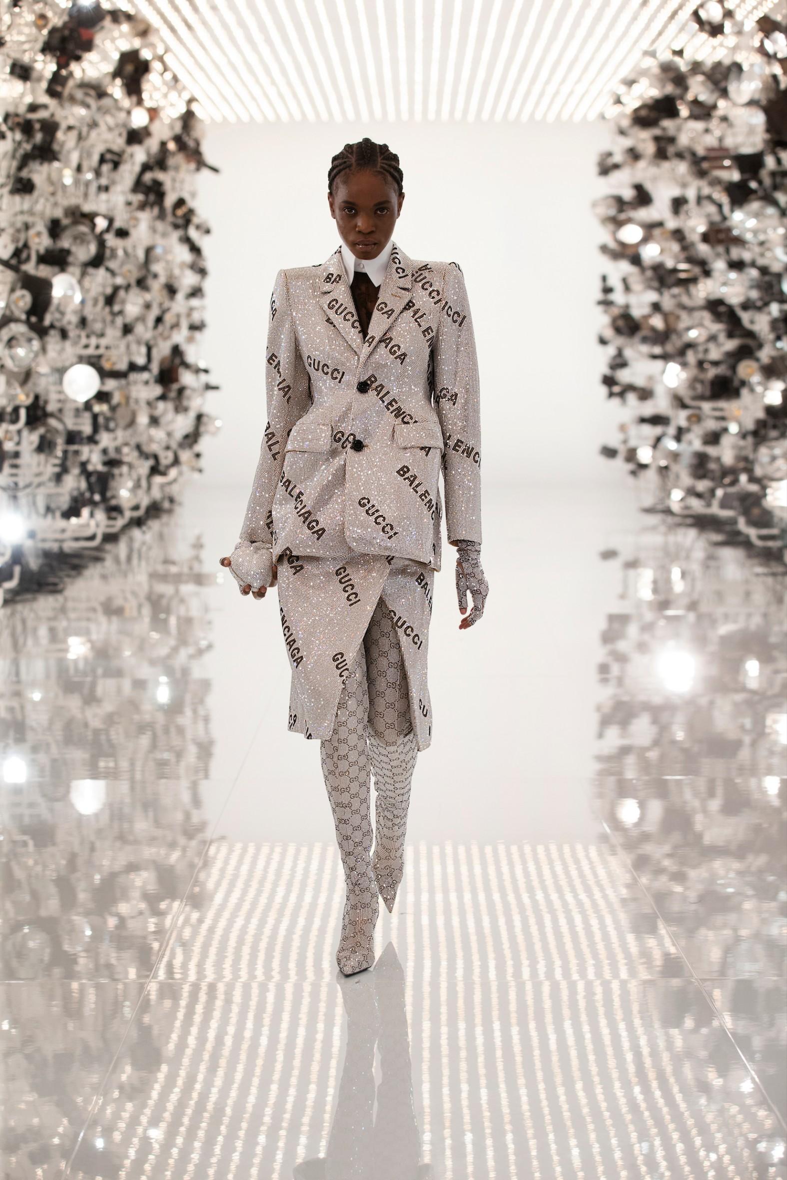 A model walking the runway of Gucci's Aria show wearing a Gucci x Balenciaga collaboration look