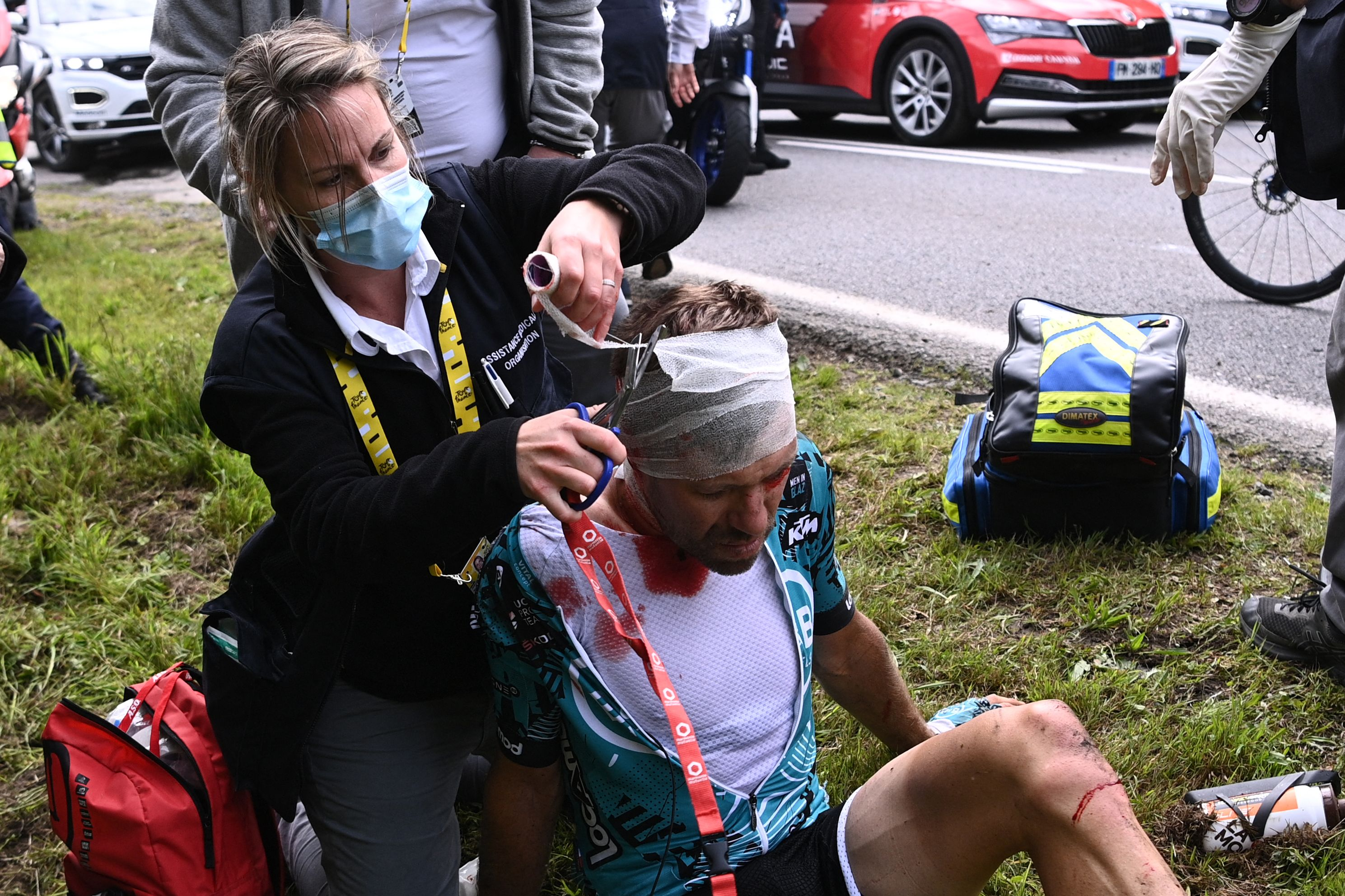 Cyril Lemoine receives treatment at the roadside following Saturday's crash. Photo: ANNE-CHRISTINE POUJOULAT/POOL/AFP via Getty Images