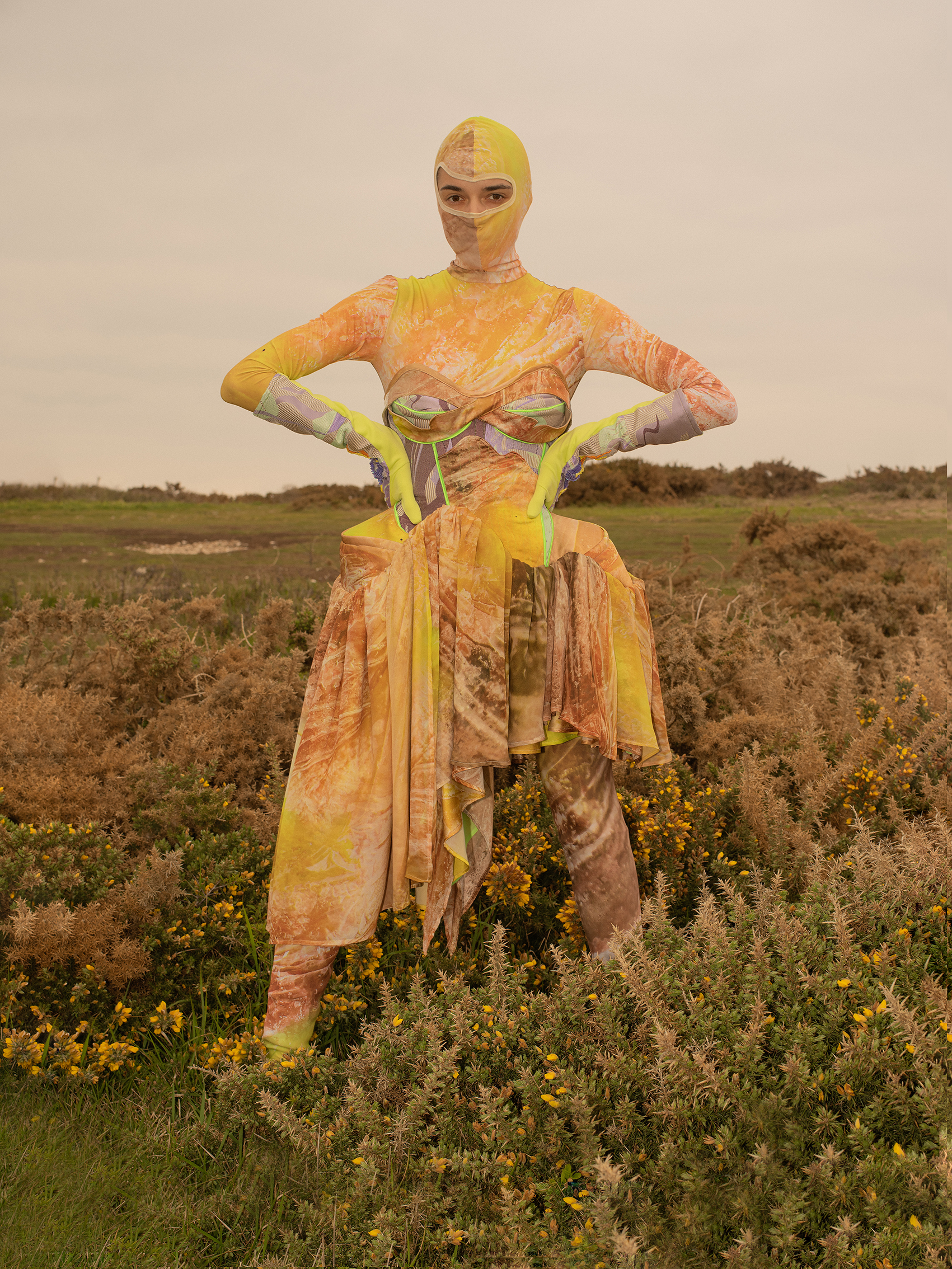 A model in a heather-y heath wearing a full look from Anna Deller-Yee's RCA MA graduate collection