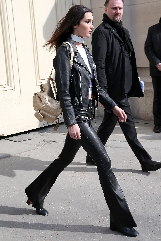 bella hadid wearing leather pants and walking in paris