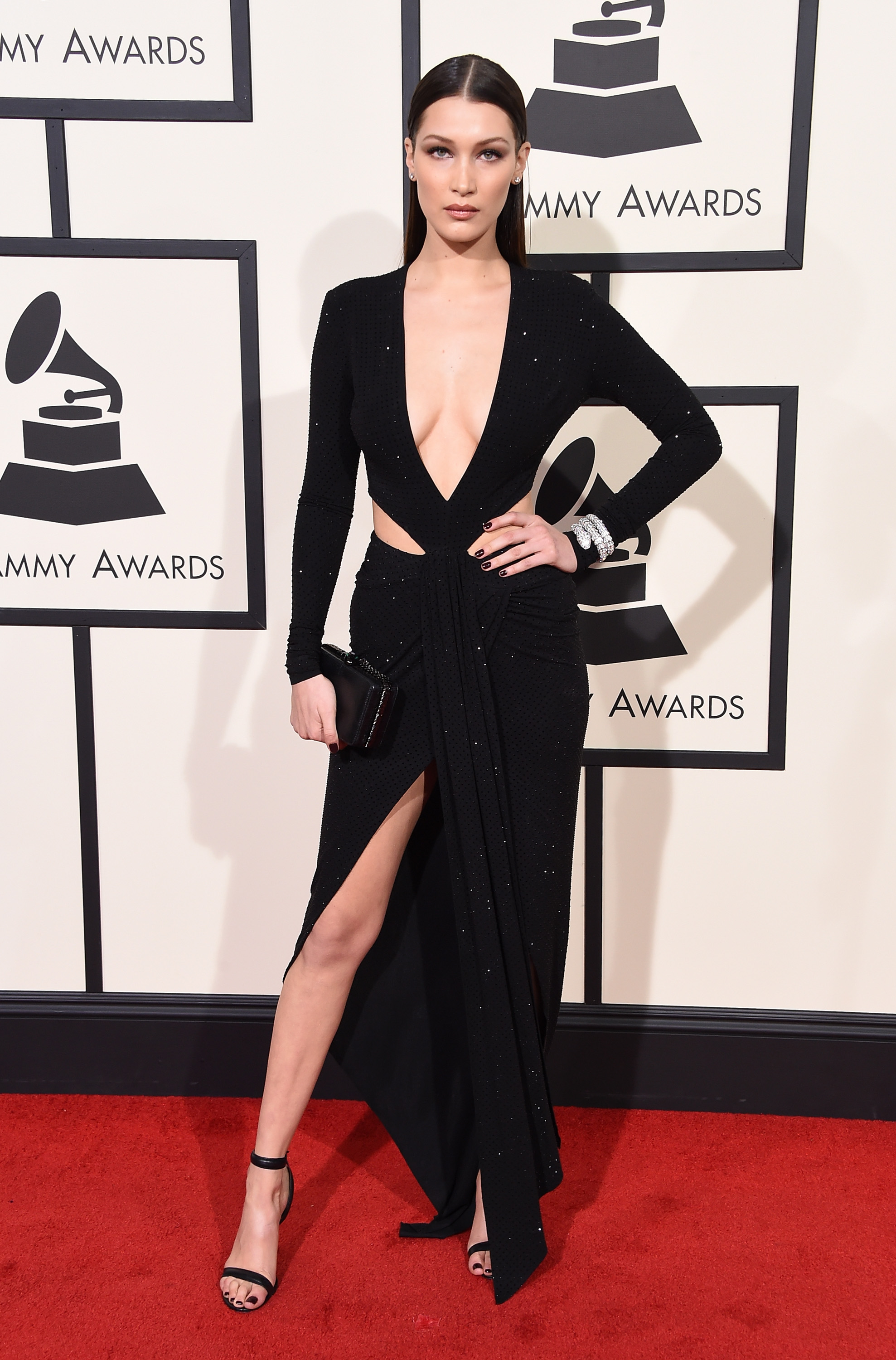 bella hadid posing on the red carpet at the grammys 2016