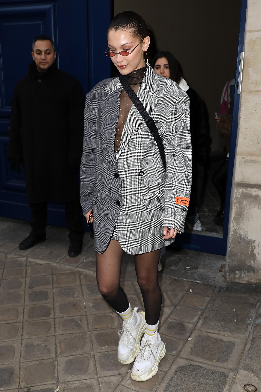 bella hadid leaving a fashion show in heron preston in paris