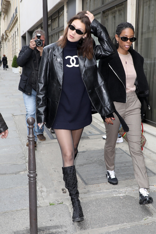 bella hadid walking down the sidewalk in paris in vintage chanel