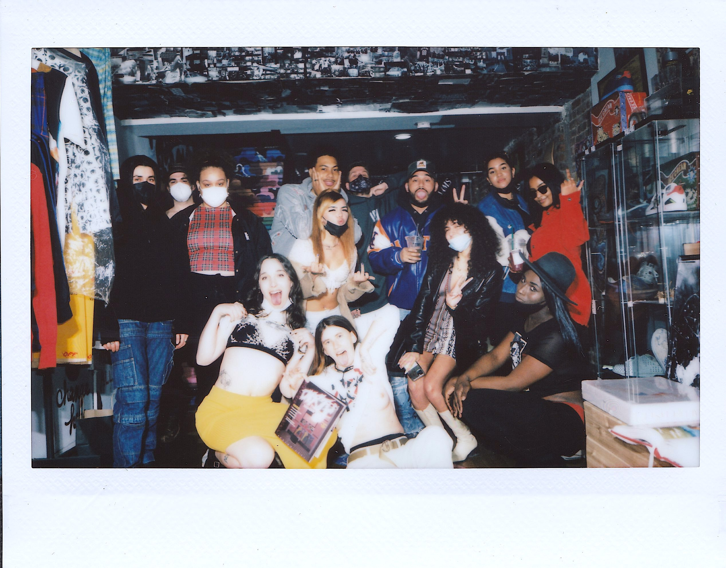 a group of dirty magazine collaborators posing in a new york apartment