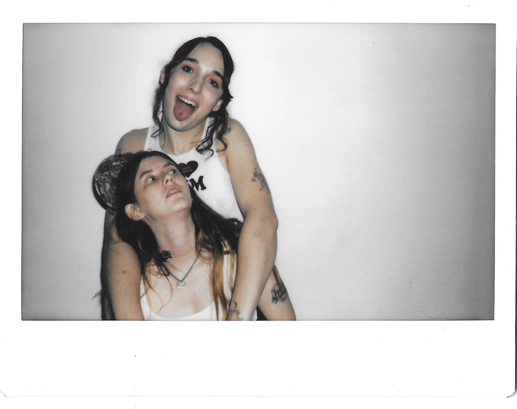 magdalena galen and ripley embracing and sticking their tongue out