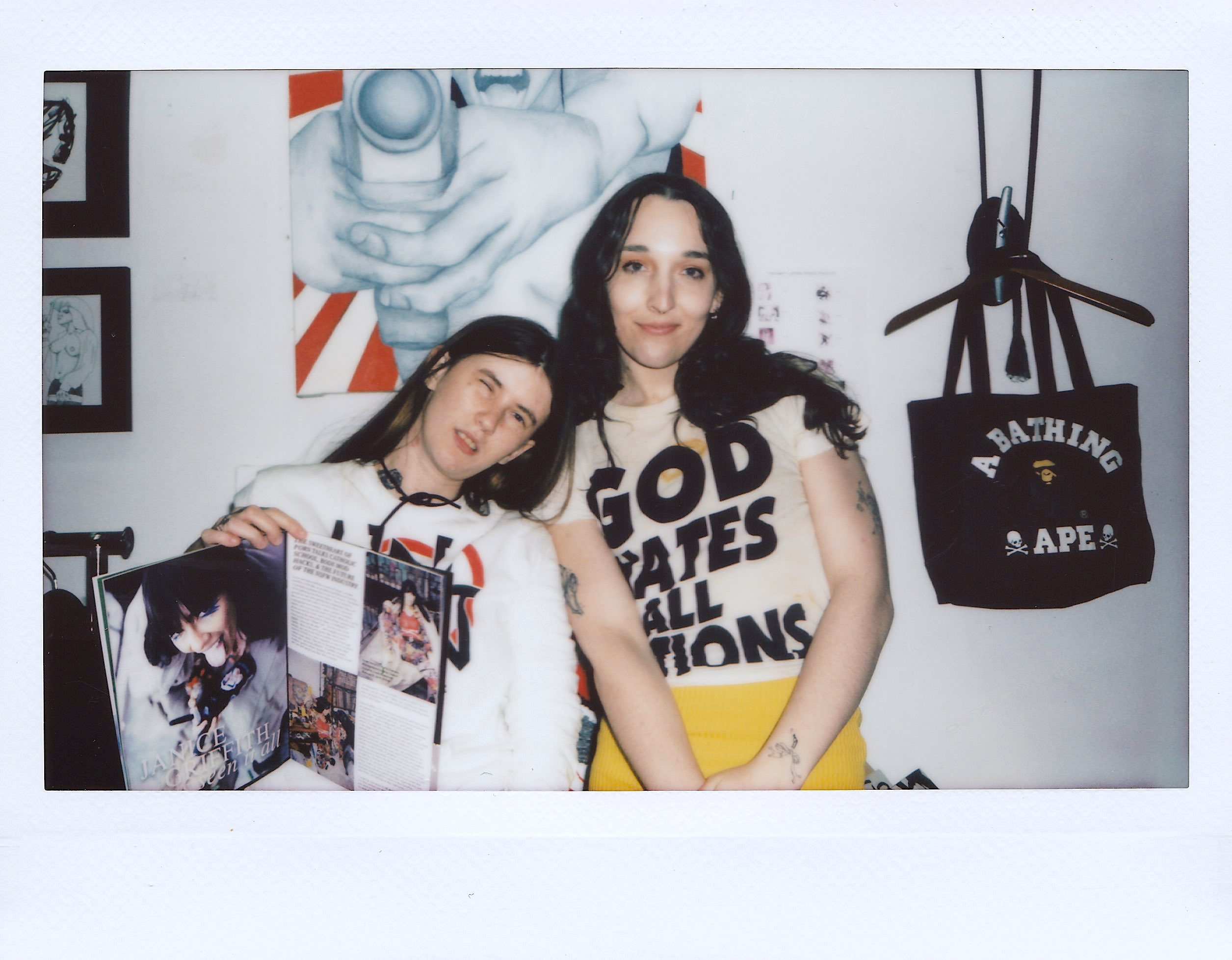 magdalena galen and ripley holding up dirty magazine and winking