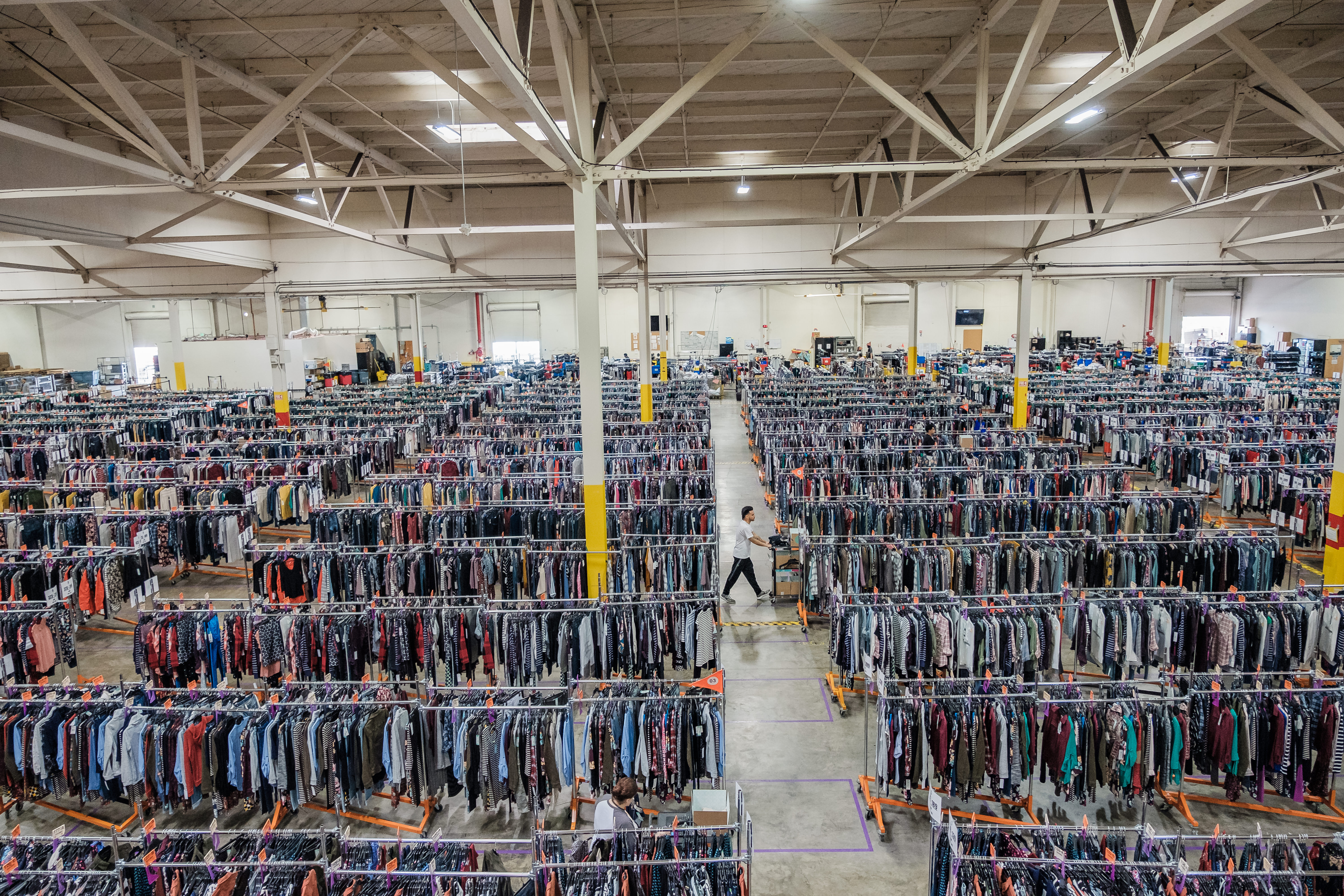 An employee can be seen pulling clothes at one Stitch Fix's warehouses, in South San Francisco