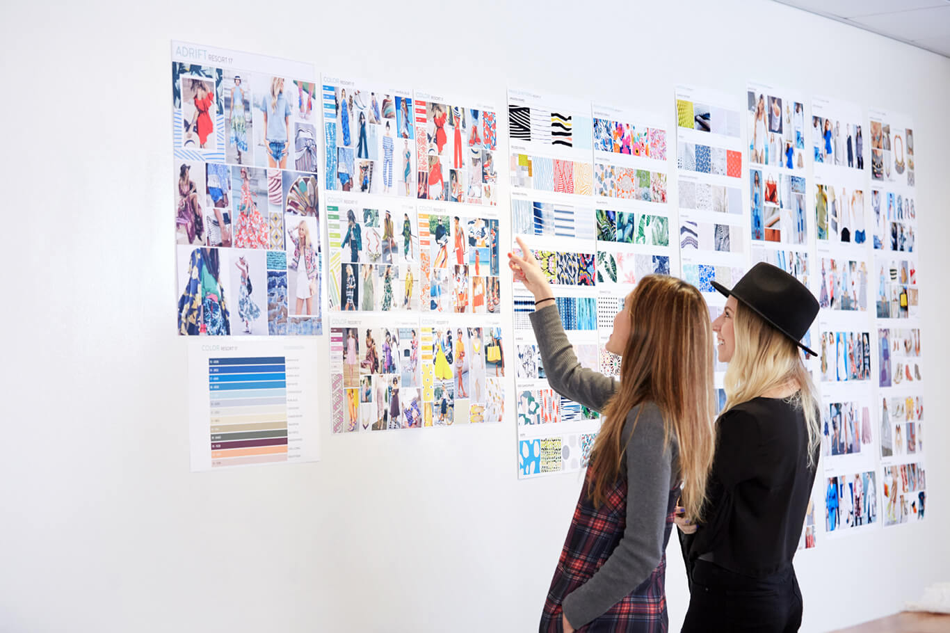 Two women pointing at a style board at the Stich Fix headquarters.