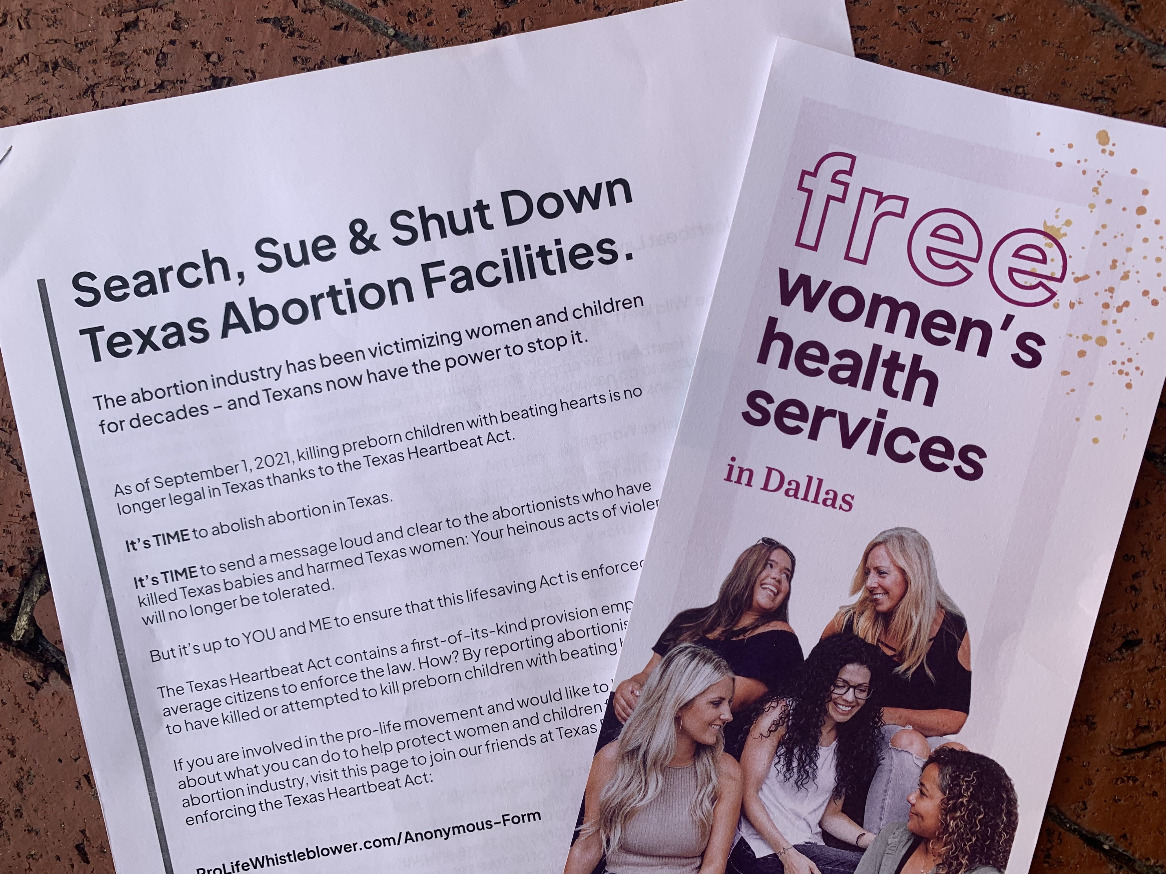Anti-abortion advocates from the group Students for Life of America pass out a brochure that instructs Texans on how to