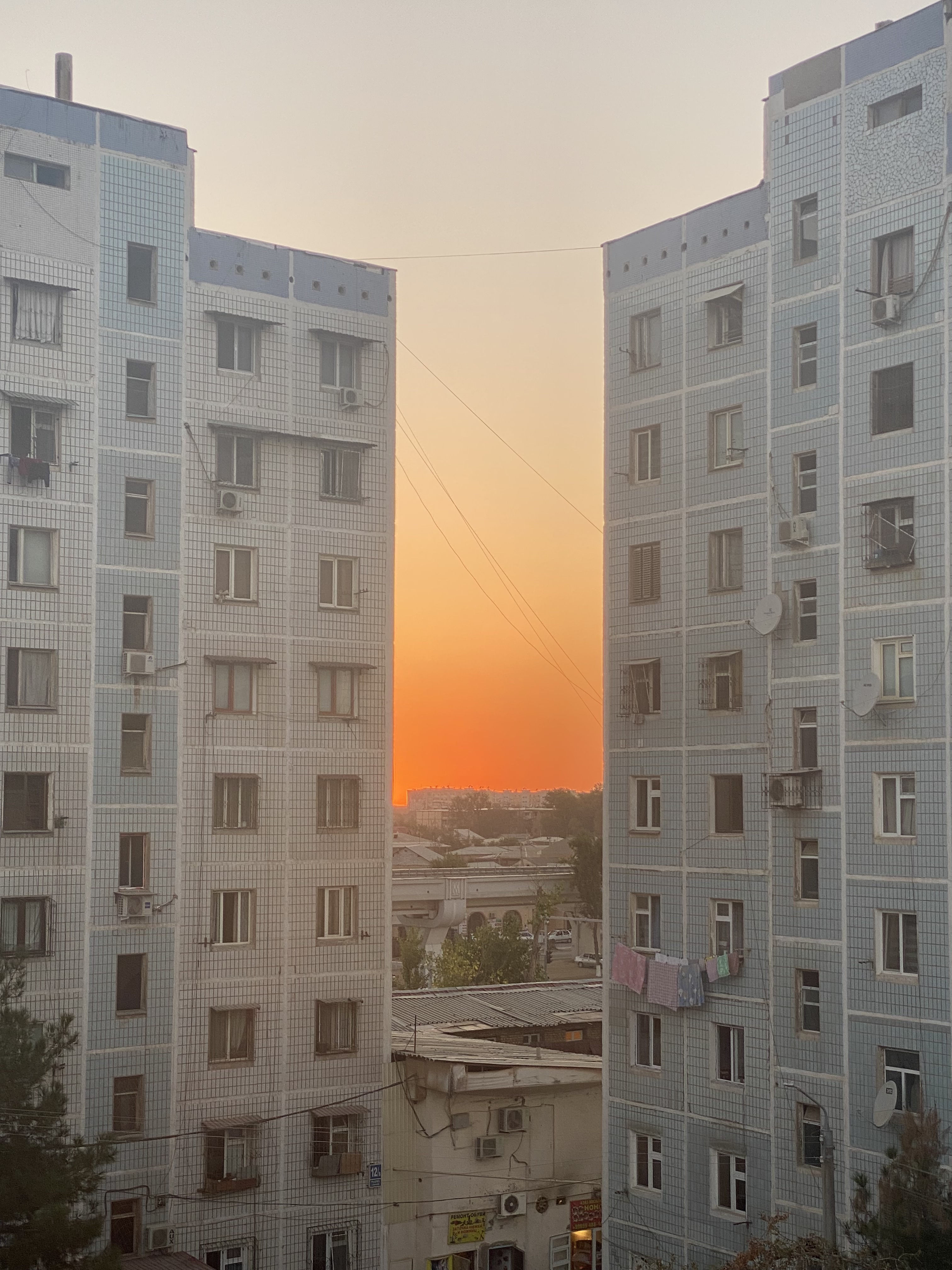 The sunset between old buildings