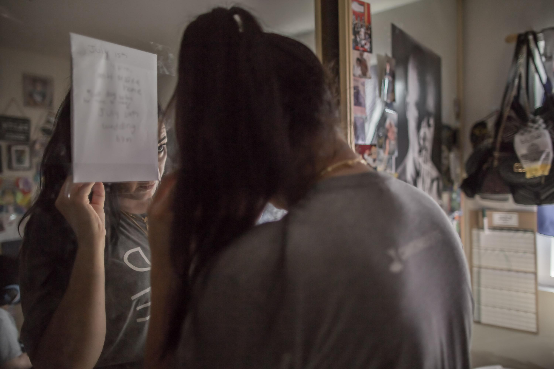 Noor Salman stands in her home.