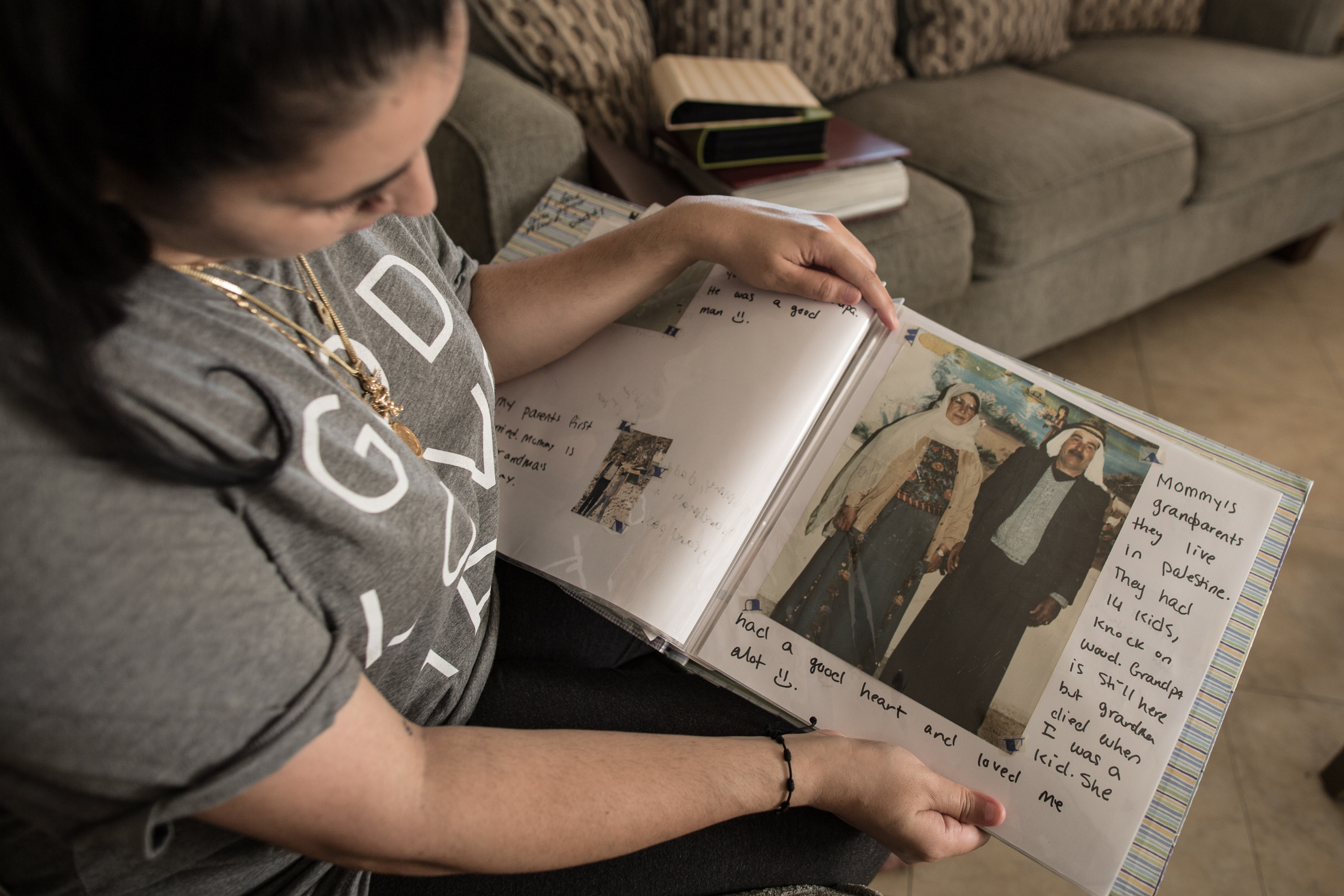Noor Salman holds a photo album with a picture of her grandparents in Palestine.