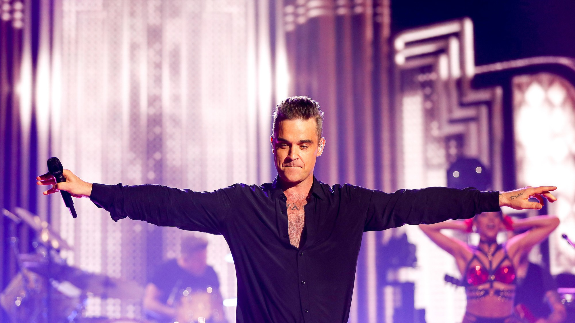 Robbie Williams: The Great British Pop Star Who Will Never