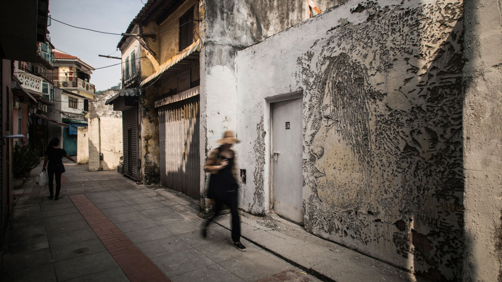 A Fearless Street Artist Carves on Walls with Explosives, Drills, and Acid