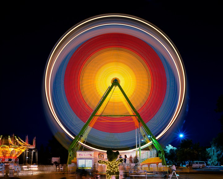 Carnival Rides Become Geometric Light Paintings in Long-Exposure Photos
