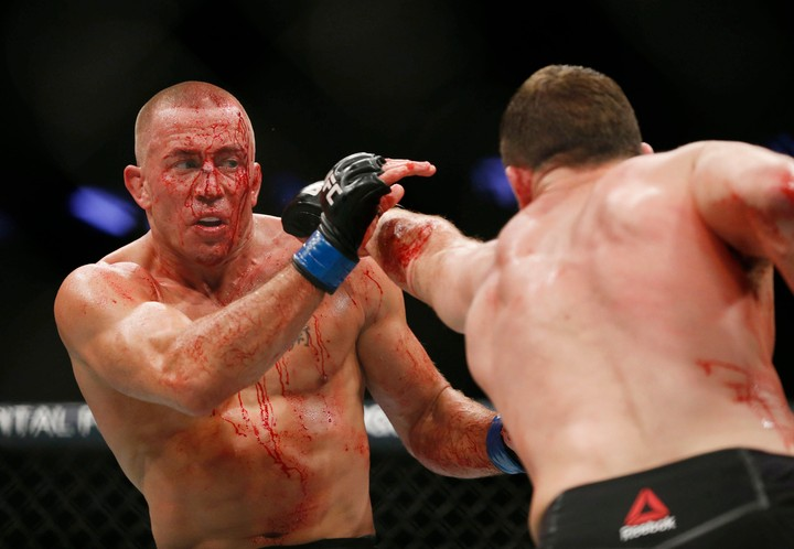 20d4dc441a0 How Georges St-Pierre Made History at UFC 217 and Took Bisping s Belt - VICE