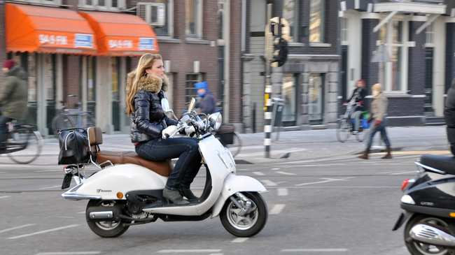 Cyclists Hate Scooters So Amsterdam Is Banning Them From Bike Lanes