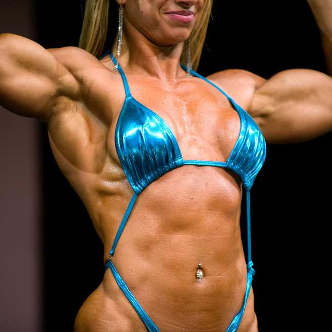 Inside the Lucrative World of Female Muscle Worship, Where Men Pay to Touch