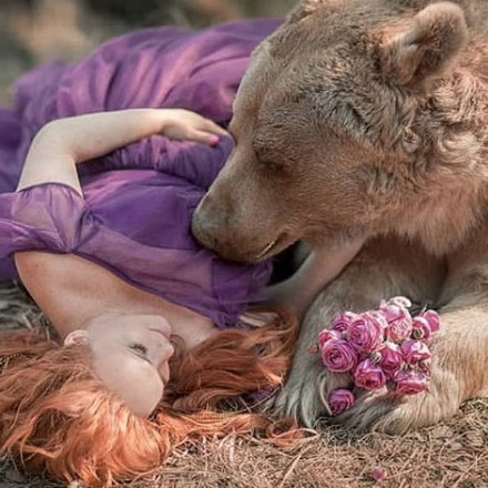Bear having sex with a woman