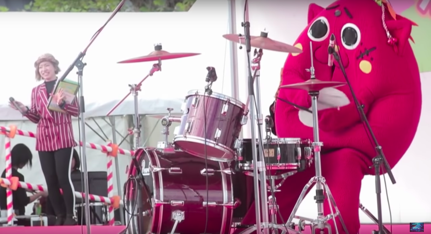 This Adorable Cat Mascot Thing Can Shred The Drums
