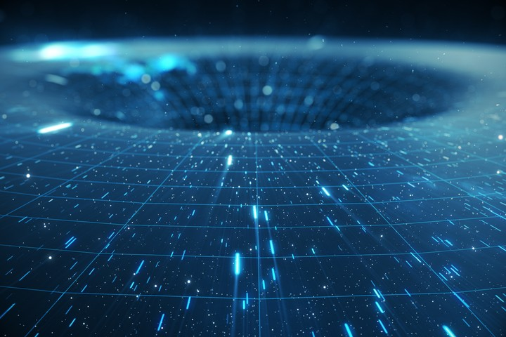 The Government's Secret UFO Program Funded Research on Wormholes and Extra Dimensions