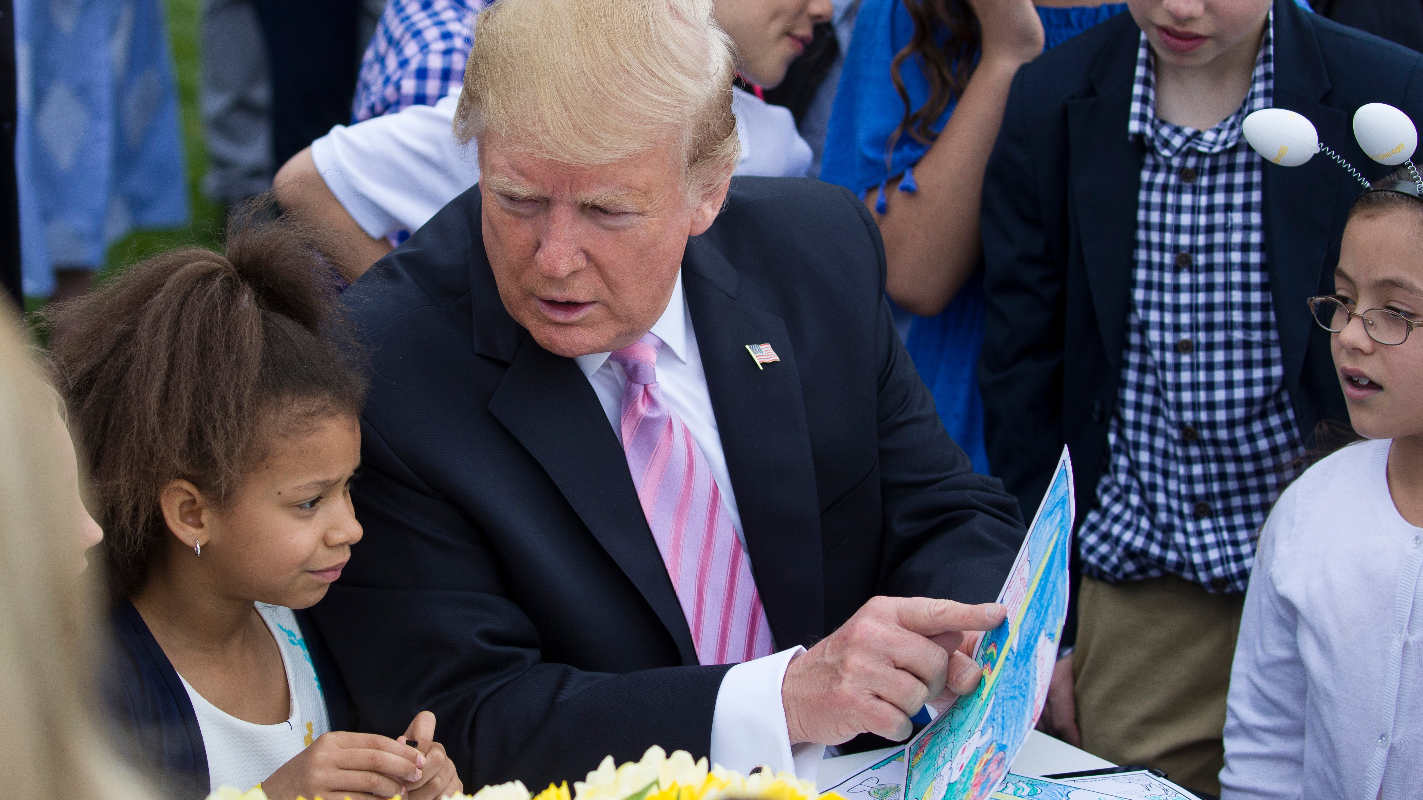 Trump assures kids at the White House Easter Egg Roll that the wall is happening
